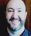 A picture of Tim Kurteff-Schatz smiling